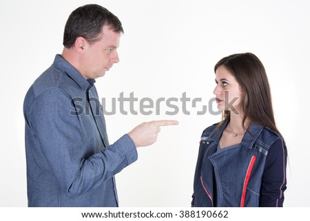 Unhappy father, conflict with his teenager isolated on white - stock photo