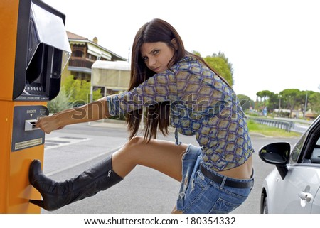 Unhappy female model trying to get back money from cash machine - stock photo
