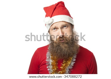 unhappy funny santa claus with real beard and red hat and shirt looking at camera with sadness. isolated on white. isolated on white background. - stock photo