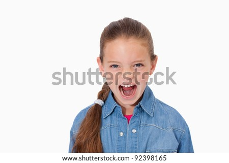 Unhappy girl screaming against a white background - stock photo
