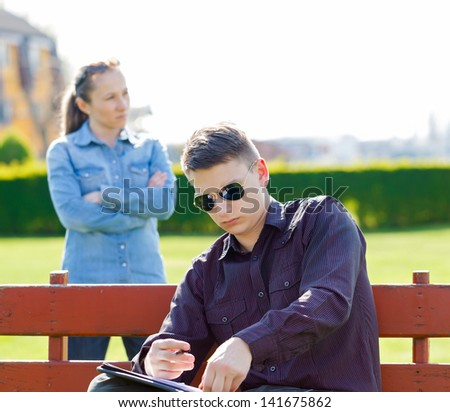 Unhappy girl upset on her boyfriend because his workaholic - stock photo