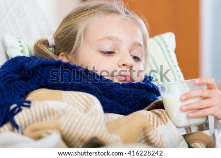 Unhappy little girl suffering of sore throat and fever  - stock photo