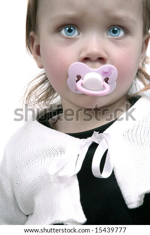Unhappy looking baby with pacifier - stock photo