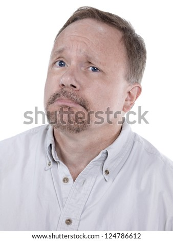 Unhappy old man frowning in a close-up image