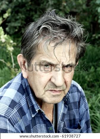 unhappy old man outdoor - stock photo