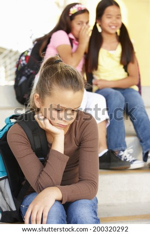 Unhappy Pre teen girl in school - stock photo