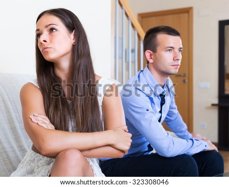 Unhappy spouses having bad argue in livingroom at home