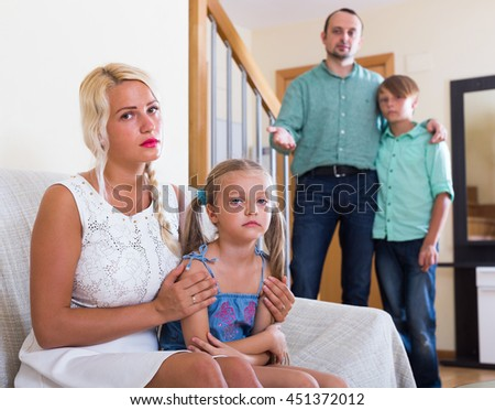 Unhappy tired parents and two kids in bad conflict at home