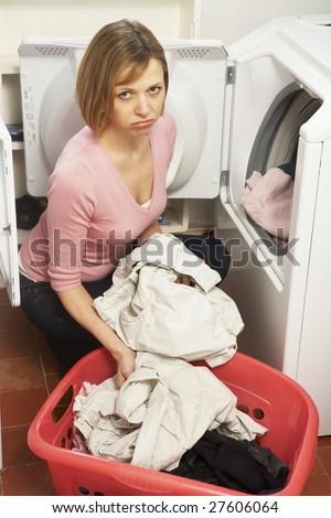 Unhappy Woman Doing Laundry - stock photo