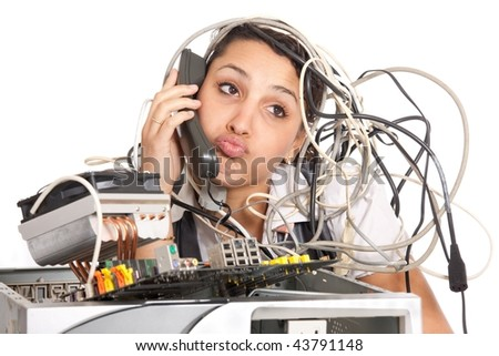 unhappy woman  having problems with computer trying to reach support line - stock photo