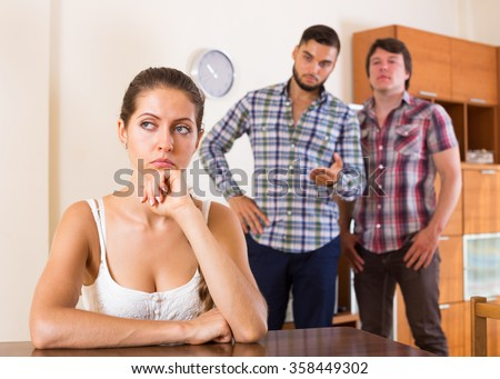 Unhappy woman having troubles with partners at home