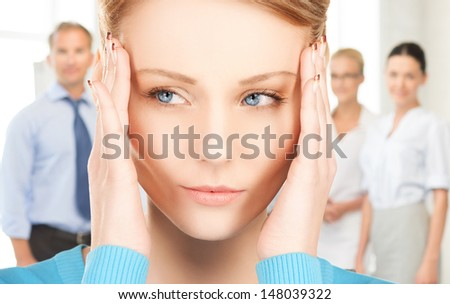 unhappy woman holding her head with hands - stock photo