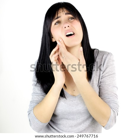 Unhappy woman isolated holding her jaw for pain - stock photo