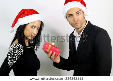 unhappy young couple for a gift at Christmas
