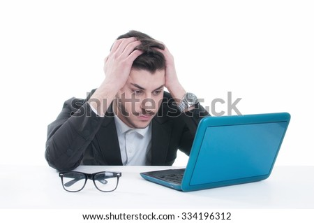 Unhappy young man looking on his Laptop