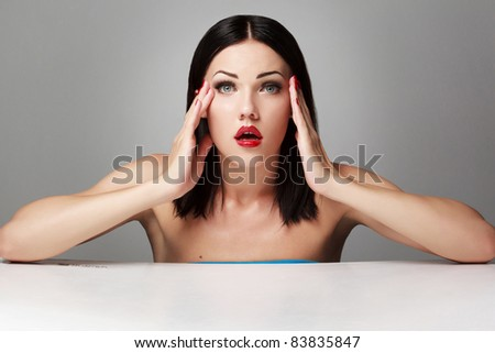 Unhappy young woman  on grey background - stock photo