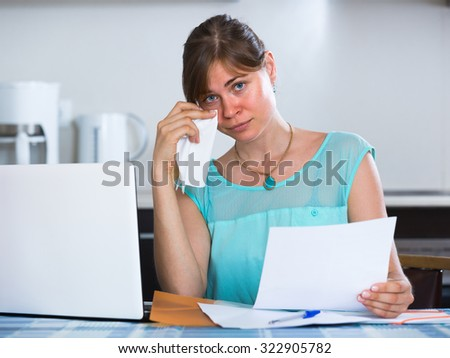 Unhappy young woman receiving bank refuse about delay of payment - stock photo