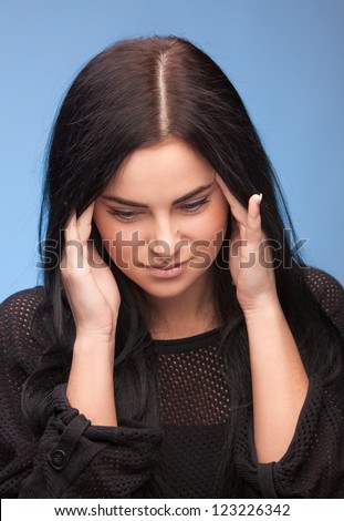 Unhappy young woman with bad headache