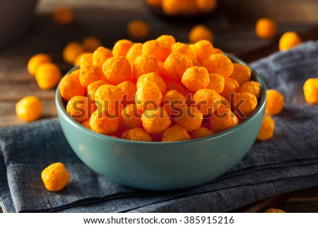 Unhealthy Cheesy Cheese Puffs in a Bowl - stock photo