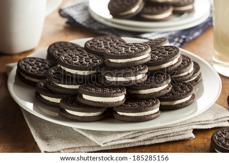 Unhealthy Chocolate Cookies with Vanilla Cream Filling - stock photo
