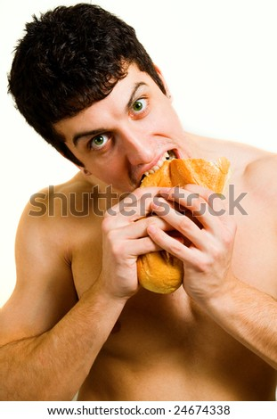 Unhealthy food - hungry man eating bread isolated on white - stock photo