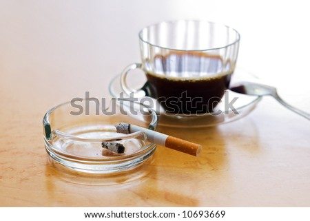 Unhealthy habits - strong coffee and a smoking cigarette - stock photo