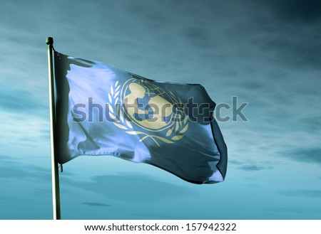 UNICEF flag waving in the evening - stock photo