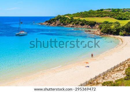 Unidentified couple of young people relaxing on beautiful Grande Sperone beach, Corsica island, France - stock photo