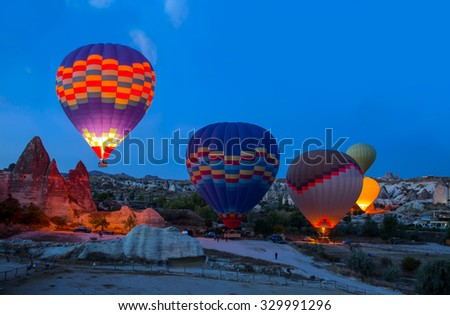 Unidentified crew preparing hot air baloon to fly - stock photo