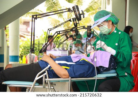Unidentified dentist from public hospital are in medical services at Hospital of Health Promotion on October 9,2012  in Khao-kaew Subdistrict Municipality, Chiang khan, Loei, Thailand    - stock photo