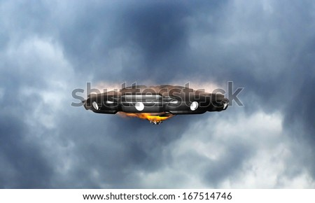 unidentified flying object in the sky - stock photo