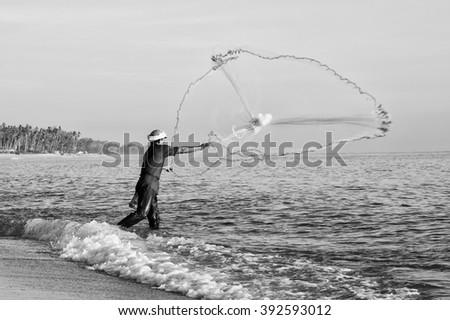 Unidentified local fisherman fishing using nets - stock photo