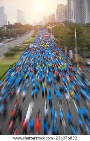 Unidentified marathon runners on the street  - stock photo