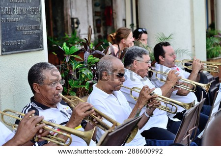 Unidentified musicians performing with a trumpets in street orchestra in Havana, Cuba on May 10, 2013. - stock photo