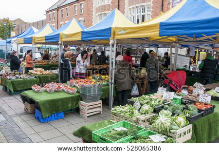 Unidentified people shop for fruits and vegetables at Farmers Market in Bournemouth on November, 2012