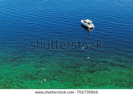 Unidentified people swim in the Adriatic Sea near Piran, Slovenia.