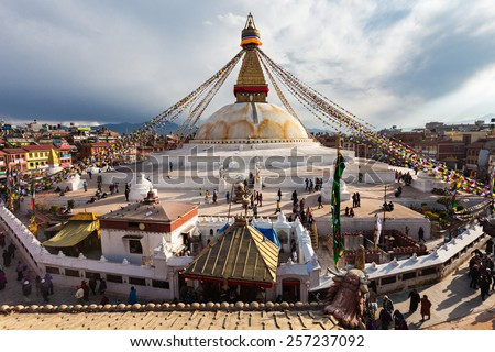 Unidentified pilgrims at the Boudhanath stupa in Kathmandu, Nepal - stock photo
