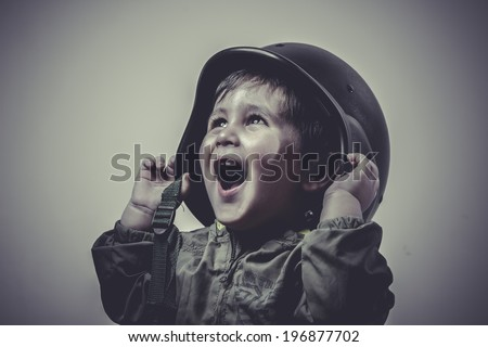 uniform, fun and funny child dressed in military cap, playing war games - stock photo