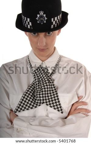 Uniformed UK female police officer giving stern look isolated on white - stock photo