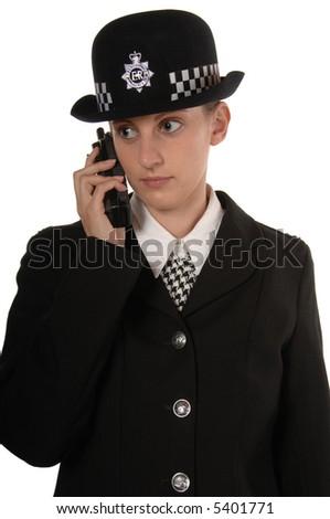 Uniformed UK Female Police Officer Listening to Radio isolated on white - stock photo