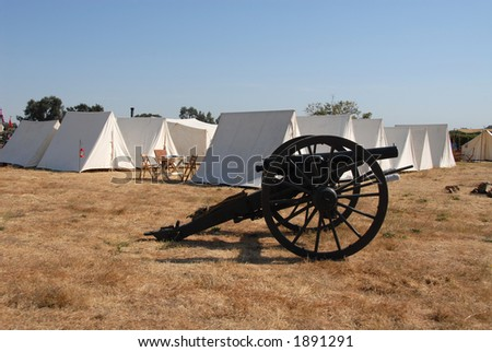 Union camp with cannon, Civil War reenactment, Clements, California - stock photo