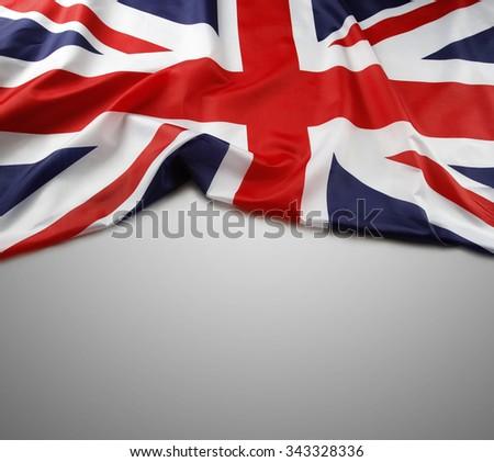 Union Jack flag on grey background - stock photo