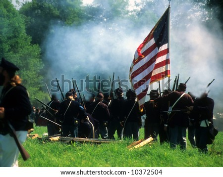 Union line preparing to fire, Civil War battle reenactment - stock photo