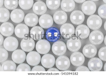 stock-photo-unique-blue-pearl-among-many