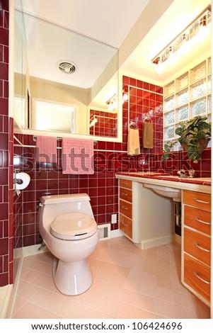 Unique burgundy antique bathroom interior design. - stock photo