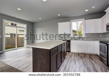 Unique Kitchen With Gray Hardwood Floor Well As Walls And White Cabinets
