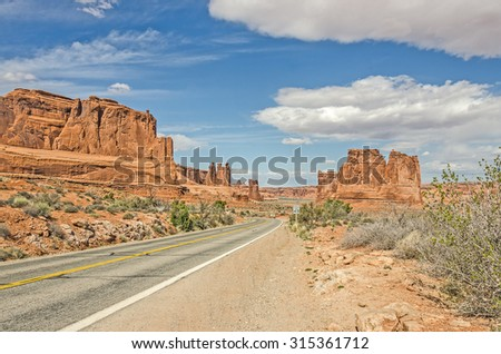 Unique landscape of entrada sandstone formations along a main road in Arches National Park - stock photo