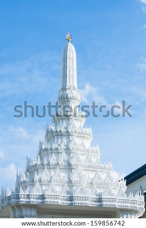 Unique pattern of white pagoda Thailand. On the bright sky. - stock photo