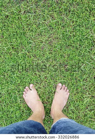 unique perspective barefoot relax on grass green background
