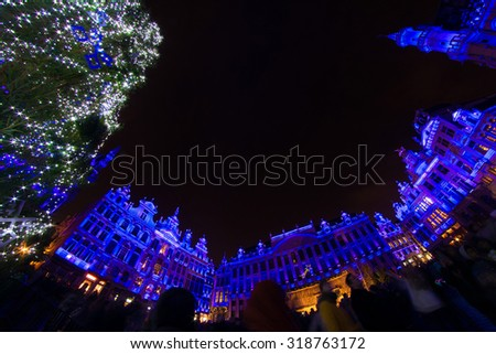 Unique perspective of blue-illuminated Grand Place, the focal point of Brussels, Belgium, at Christmas